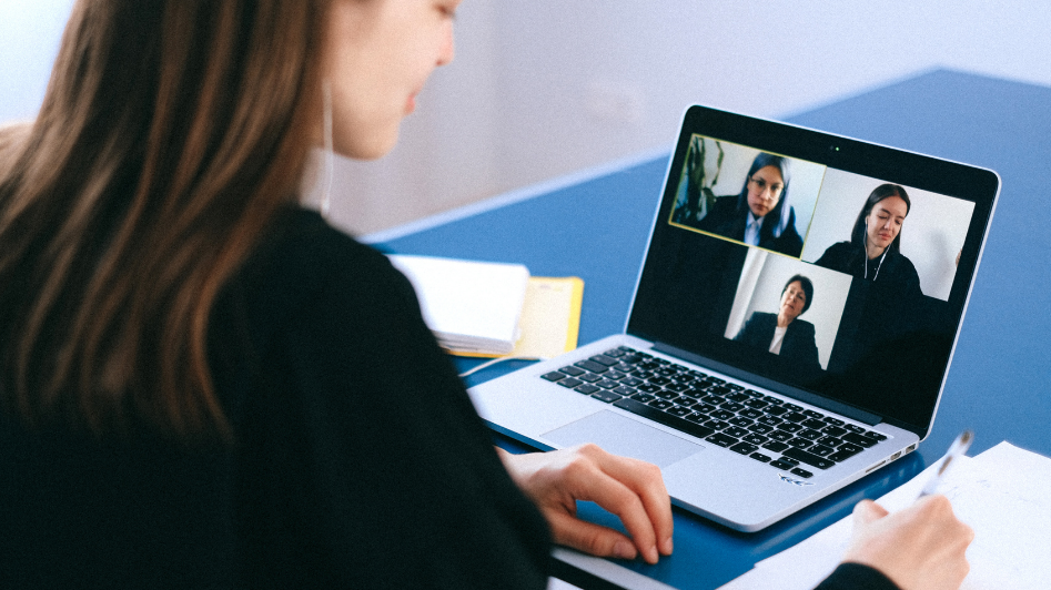 Woman holding a virtual meeting with colleagues
